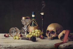 Vanitas witch Skull; Pipe, tobacco, wine glass, wine and grape Royalty Free Stock Image