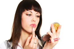 Vanity. Tenage girl applying lipstick looking in the mirror Royalty Free Stock Photography