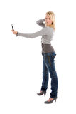 Vanity. Cute young girl taking a photo of herself with her mobile phone Stock Image