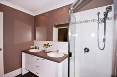 Vanity Bathroom. A small modern bathroom and vanity with twin sinks Royalty Free Stock Images