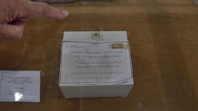 Vank Cathedral smallest book. ISFAHAN, IRAN - MAY 8, 2015: The smallest book in the world in the Vank Cathedral, armenian quarter of the city stock video footage