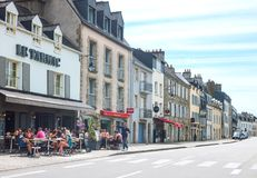 Landscapes and architectures of Brittany. Vannes, France - August 7, 2017: The houses and the open air restaurants of  Le Dressay street along the canal of the Royalty Free Stock Photography
