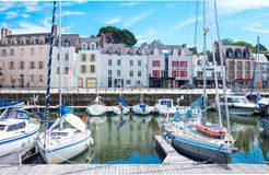Landscapes and architectures of Brittany. Vannes, France - August 7, 2017: The houses and venues of  Le Dressay street along the canal of the port Royalty Free Stock Images