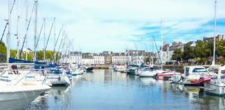 Landscapes and architectures of Brittany. Vannes, France - August 7, 2017: Leisure boats moored  in canal of the port Royalty Free Stock Image