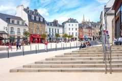 Landscapes and architectures of Brittany. Vannes, France - August 7, 2017: Local people and tourists in Des Lices square   near the Covered Market Stock Image