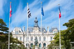 Landscapes and architectures of Brittany. Vannes, France, the Town Hall with the monument to the Duke of Richemont in the foreground Stock Images