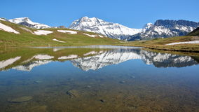 VANOISE, FRANCE : View of four summits Rechasse, Grande Casse, Grande Motte and Pierre Brune from a lake in Northern Alps. View of four summits Rechasse, Grande Royalty Free Stock Photography