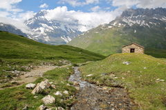 VANOISE, FRANCE:View of Grande Casse summit with St Barthelemy Chapel in the foreground, Northern Alps Royalty Free Stock Photo