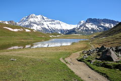 VANOISE, FRANCE : View of three summits Grande Casse, Grande Motte and Pierre Brune from a lake in Northern Alps. View of three summits Grande Casse, Grande Stock Images