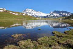 VANOISE, FRANCE : View of three summits Grande Casse, Grande Motte and Pierre Brune from a lake in Northern Alps. View of three summits Grande Casse, Grande Stock Photos