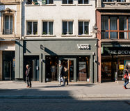 Vans American apparel store in France pedestrians walking in fro Royalty Free Stock Images