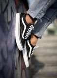 Vans Old Skool shoes in action. Milan, Italy - September 28, 2017: Vans Old Skool shoes in the street - illustrative editorial Stock Photography