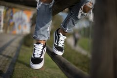 Vans Old Skool shoes in action. Milan, Italy - September 28, 2017: Vans Old Skool shoes in the street - illustrative editorial Royalty Free Stock Photo