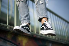 Vans Old Skool shoes in action. Milan, Italy - September 28, 2017: Vans Old Skool shoes in the street - illustrative editorial Royalty Free Stock Images