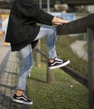 Vans Old Skool shoes in action. Milan, Italy - September 28, 2017: Vans Old Skool shoes in the street - illustrative editorial Stock Image