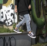 Vans Old Skool shoes in action. Milan, Italy - September 28, 2017: Vans Old Skool shoes in the street - illustrative editorial Stock Images