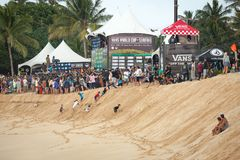 Vans World Cup of Surfing Sunset Beach. SUNSET BEACH, HAWAII, USA - DECEMBER 2: Kids playing in sand and spectators watching at the 2017 Vans World Cup of Stock Image
