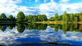 Vansjo lake in Norway. Sky reflecting on the Vansjø lake in the municipality of Moss in Norway in the summer Stock Images