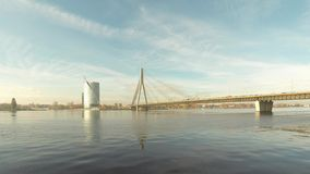 Timelapse of the Vansu bridge over river Daugava Riga Latvia. Vansu bridge over river Daugava Riga Latvia. suny autumn day stock footage
