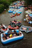 VANTAA, FINLAND – AUGUST 1, 2015: Beer Floating (kaljakellunta. ), summer event, where the participants float down the Vantaa River using small rubber royalty free stock photo