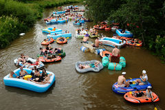 VANTAA, FINLAND – AUGUST 1, 2015: Beer Floating (kaljakellunta. ), summer event, where the participants float down the Vantaa River using small rubber crafts Royalty Free Stock Photo