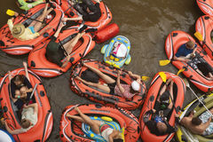 VANTAA, FINLAND – AUGUST 1, 2015: Beer Floating (kaljakellunta. ), summer event, where the participants float down the Vantaa River using small rubber crafts Stock Images