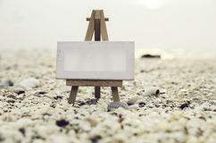 Vantage look image of white canvas on wooden easel Stock Image