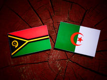 Vanuatu flag with Algerian flag on a tree stump isolated Stock Photo