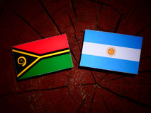 Vanuatu flag with Argentinian flag on a tree stump  Royalty Free Stock Photo