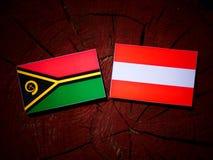Vanuatu flag with Austrian flag on a tree stump  Stock Photography