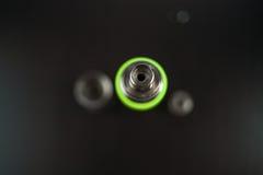 Vape Delar av e-cigaretten på en svart bakgrund Elektroniskt cigarettslut upp royaltyfria foton