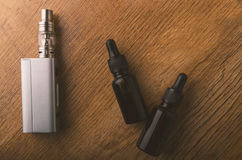 Vape device or electronic cigarette with vaping tools and access. Tools for vaping device, electronic cigarette, e-cigarette, box mod, accessories isolated over royalty free stock images