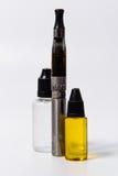 Vape E-Cig black and vape juice bottles overlap Royalty Free Stock Photography