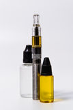 Vape E-Cig and vape juice bottles overlap Royalty Free Stock Photography