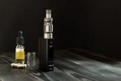 Vape or e-cigarette. Vaping set on the table. Vape or e-cigarette. Vaping set on the wooden table royalty free stock image