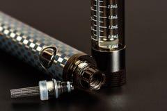 Vape eletrônico do cigarro no olhar classificado Imagens de Stock