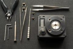 Vape Hjälpmedel för reparation och underhåll av den elektroniska cigaretten arkivbilder