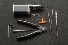 Vape Hjälpmedel för reparation och underhåll av den elektroniska cigaretten arkivfoton