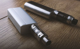 Vape pen and vaping devices, mods, atomizers, e cig, e cigarette royalty free stock photography