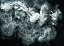 Vape ring like smoke ring on dark background Royalty Free Stock Photography