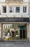 Vape Shop downtown Brussels, Belgium. Brussels, Belgium - September 26, 2018: Vapotheque is a Vape shop on Rue des Fripiers downtown. CBD poster on full facade royalty free stock images
