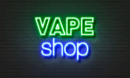 Vape shop neon sign on brick wall background. Vape shop neon sign on brick wall background royalty free stock images