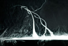 Vape sztuczki tornado na ciemnym tle Zdjęcie Stock