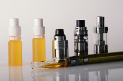 Vape tanks and e liquid for electronic cigarette or e c. Ig over a white background. vaping rdta and e juice for vaping devices stock image