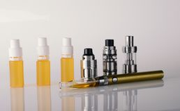 Vape tanks and e liquid for electronic cigarette or e c. Ig over a white background. vaping rdta and e juice for vaping devices royalty free stock images
