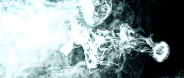 Vape trick smoke ring on dark background stock image