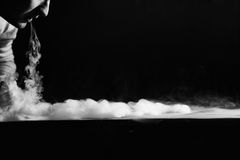 Vape trick waterfall in performance of vaper on dark background.  stock image