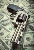 Vapen och pengar Arkivfoto