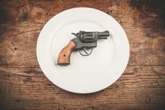 Vapen på plattan Fotografering för Bildbyråer