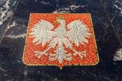 Vapensköld av Polen som föreställs i den Hanseatic springbrunnen Arkivfoto